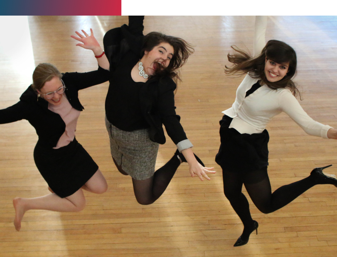 Three WLP Graduate Assistants Jumping Happily