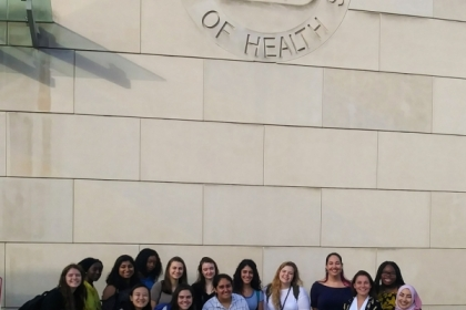 SHM students pose in front of the NIH Visitor Center