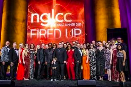 Conference members in front of the NGLCC sign