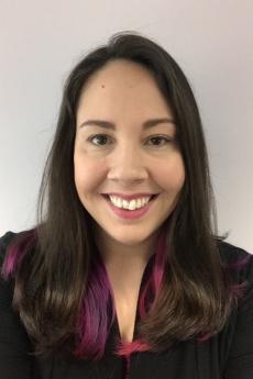 Carly Jordan, smiling headshot